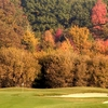 A fall view of green protected by bunkers at Willow Wood Country Club