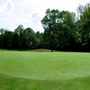 A view of green with narrow road on the left at Briar Ridge Golf & Country Club