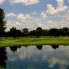 A view over the lake of a green at Oakland Hills Golf Club