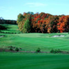 A fall view of a hole guarded by sand traps at Red from Mistwood Golf Course