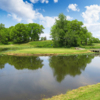 A view of green #8 surrounded by water at Shamrock Hills Golf Course
