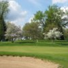 A view of green #1 protected by spring blossomed trees at Marywood Golf Club