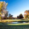 A view over the water of the 1st hole at Stonebridge Golf Club