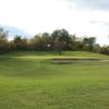 A view of the 9th green flanked by sand traps at Hidden Oaks Golf Course