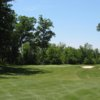 A view of the 17th green protected by sand traps at Pierce Lake Golf Course