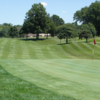 A view of a green and a fairway at Grosse Ile Golf & Country Club