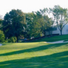 A view of a green protected by bunkers at Bloomfield Hills Country Club