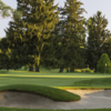 A view of a green protected by bunkers at Knollwood Country Club