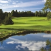 A view over the water of hole #7 at The Spruce Run Course from Grand Traverse Resort & Spa