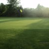 A sunny day view of a green at Summer Breeze Par 3