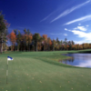 A view of a hole guarded by fall trees at Black Lake Golf Club