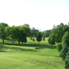 A view of a green protected by bunkers at Devils Lake Golf Course