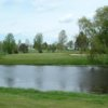 A view over the water of a green at River's Edge Golf Club