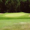 A view of a green flanked by tricky sand traps at Inverness Country Club
