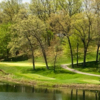 A view over the water of a green at Kalamazoo Country Club