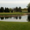 A view of a green with water coming into play at Huckleberry Creek Golf Course
