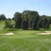 A view of a green protected by bunkers at Gull Lake Country Club