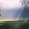 A view of a green gently touched by the sunshine at Cascades Golf Course