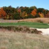 A fall day view of a well protected green at Forest Dunes Golf Club.