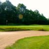 A view of a hole protected by a manicured bunker at Thoroughbred Golf Club.