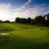 A sunny day view of a green at Oakland Hills Country Club.
