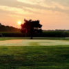 A sunset view of a green at Broadway Acres Golf Course.