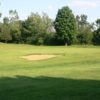 A sunny day view of hole #1 at Pine Hills Golf Course.