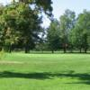 A sunny day view of a green at Southmoor Golf Course.