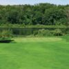 A view of a green with water in background at Lakeside Links Golf Course.