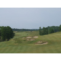 The par-5 first hole at the Kingsley Club features a double fairway split by a collection of bunkers.