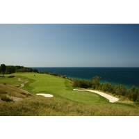 The par-4 opener on the Links course at Bay Harbor Golf Club plays on bluffs above Lake Michigan.