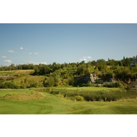 The par-4 fifth hole on the Quarry course at Bay Harbor Golf Club features a green sitting right beneath a quarry wall.