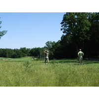 Golfers unload on the 18th tee at Pilgrim's Run Golf Club in Pierson, Michigan.