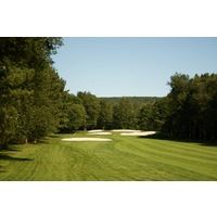 Boyne Highlands Resort's Heather course's  par-5 11th hole is guarded heavily around the green by bunkers.