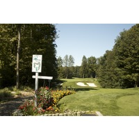 The first hole on the Threetops golf course at Treetops Resort is a 143-yard par 3 to a perched green.