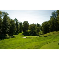 The eighth hole on the Threetops golf course at Treetops Resort plays gently downhill and is 140 yards from the championship tees.