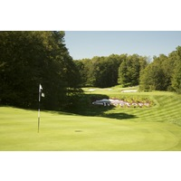 The ninth hole on the Threetops golf course at Treetops Resort plays over a valley to a green at 140 yards.