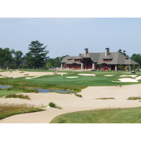 Forest Dunes GC - the 19th green and clubhouse