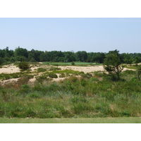 The 17th hole at Forest Dunes Golf Club plays completely over wasteland.