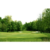 The Orchards Golf Club's sixth hole is a snaking par 5 played through dense woods.