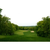 Shepherd's Hollow Golf Club's 22nd hole features an elevated tee and alternate left and right greens.