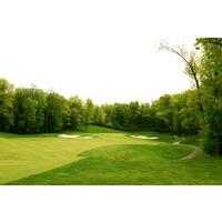 Shepherd's Hollow G.C.'s 27th hole is a long par 4 well guarded by bunkers to an elevated green.