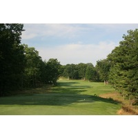 The sixth hole at Black Lake Golf Club is a par 5 that doglegs left.