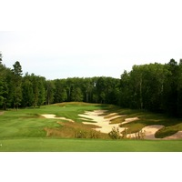 The par-3 17th hole at Black Lake Golf Club features a waste bunker along the left side.