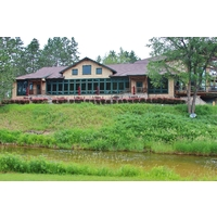 The Hidden River Golf & Casting Club clubhouse sits above the Maple River.