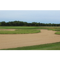 Holland-based architect Ray Hearn used sand and water to defend the flat terrain at Macatawa Legends Golf & C.C. in Holland, Mich.